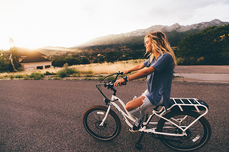 Young woman on bike
